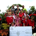 The pupils of Binsted Primary School receiving the £1,000 cheque